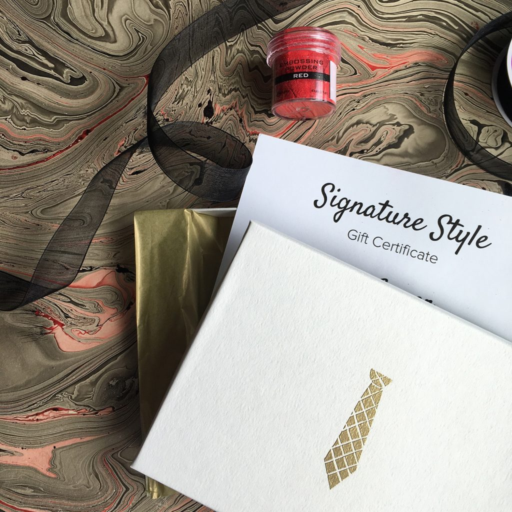 styled gift card with gold embossed tie on the card