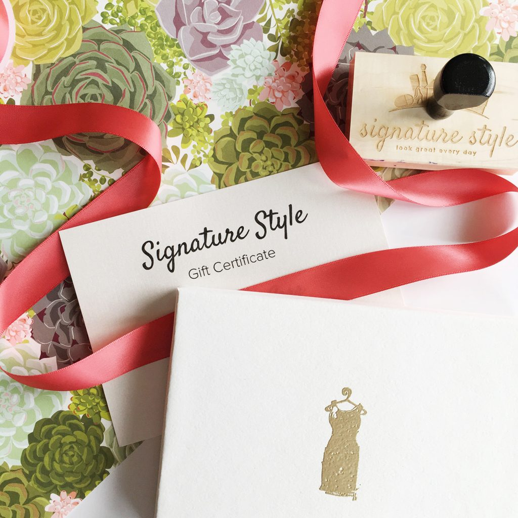styled gift cards with gold embossed dress on the card